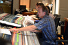 Scoring mixer Jeff Vaughn adjusts the levels