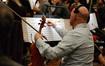 A violist makes edits to his part