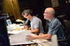 Orchestrator John Ashton Thomas, composer John Powell, and scoring mixer Brad Haehnel listen to a cue
