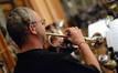 Jon Lewis blasts on the trumpet