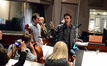 Composer Michael Giacchino and music contractor Reggie Wilson listen to director Shawn Levy address the orchestra
