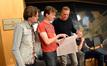 Orchestrators Jason and Nolan Livesay discuss a cue with composer John Ottman