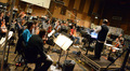 Composer Chris Lennertz and the orchestra