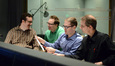 Orchestrators Michael Lloyd and Marcus Sjowall enjoy a laugh as score producer Alex Bornstein and orchestrator Andrew Kinney go over a cue