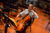 Cellist Steve Erdody warms up for his solos