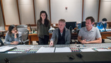 Scoring assistant Raashi Kulkarni, composers Sherri Chung and Blake Neely, and scoring mixer Greg Hayes go over a cue