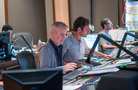 Composer Blake Neely and scoring mixer Greg Hayes check levels