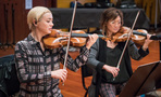 Serena McKinney and Songa Lee perform on violin