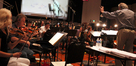 Nicholas Dodd conducts the orchestra on a cue from Mychael and Jeff Danna's score to <i>The Good Dinosaur</i>