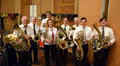 Brad Warnaar, David Everson, Steve Becknell, Amy Sanchez, John Reynolds, Joe Meyer, Brian O'Connor and Richard Todd proudly display their Wagner tubas