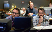 Director Colin Trevorrow and composer Michael Giacchino watch the playback with the score