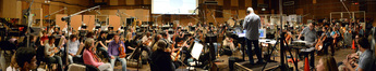 Orchestrator and conductor Tim Simonec records a cue from <i>Jurassic World</i> with the orchestra