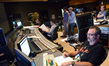 Inside the booth for the <i>Maze Runner: The Scorch Trials</i> sessions (L-R): additional music composer Braden Kimball, additional score recordist Chris Fogel, composer John Paesano, director Wes Ball, stage recordist Tim Lauber (foreground), and ProTools recordist Kevin Globerman