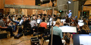 Orchestrator Tim Davies conducts the orchestra at the sessions for <i>The Peanuts Movie</i>