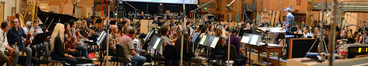 A 79-piece orchestra records records a cue from composer Christophe Beck's score to <i>The Peanuts Movie</i> under conductor and orchestrator Tim Davies
