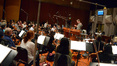 Nick Glennie-Smith conducts the orchestra