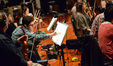 A violinist edits his part