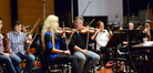 Concermaster Bruce Dukov and violinist Natalie Leggett rehearse between takes