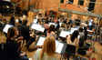 Conductor Tim Davies gives feedback to the orchestra