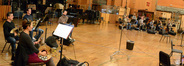 The brass section waits to record