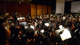 Composer and conductor John Debney and the orchestra prepare for the next cue