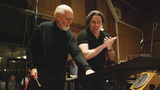 Composer John Williams and guest conductor Gustavo Dudamel review the score