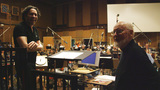 Guest conductor Gustavo Dudamel and composer John Williams enjoy a moment between cues