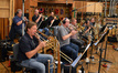 The brass: trumpets Dave Washburn, Jon Lewis, and Dan Rosenboom, trombones Steve Holtman, Alex Iles, Phil Keen, Bill Reichenbach, and tuba Doug Tornquist