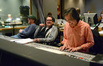 Director Brad Bird, composer Michael Giacchino, and scoring mixer Joel Iwataki listen to the mix