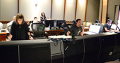 The booth listens as composer Alison Plante's concert work <i>Trimountaine</i> is recorded
