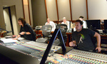 Orchestrator Suzie Katayama relays feedback from the booth with scoring mixer Adam Michalak