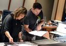 Orchestrator Suzie Katayama goes over the score with scoring mixer Adam Michalak
