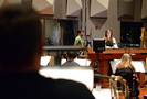 Composer/conductor Alison Plante gives feedback to the brass section