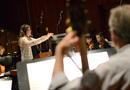 Composer Alison Plante conducts the orchestra
