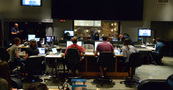 The booth watches conductor Nolan Livesay record composer John Paesano's (standing, right) score to <i>Almost Christmas</i> with the orchestra