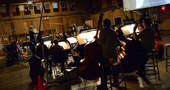 The orchestra records a cue to <i>Almost Christmas</i> with conductor Nolan Livesay
