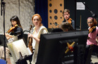 The orchestra sneaks a peak at the playback