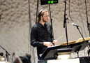 Co-composer and conductor Ludwig Göransson checks the playback