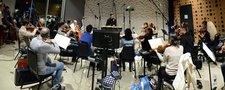 Co-composer/conductor Ludwig Göransson and the orchestra record a cue from <i>Central Intelligence</i>