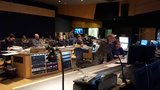 A view from the booth of Tom Holkenborg and his team hard at work at the Newman Scoring Stage at 20th Century Fox recording his score to <i>Deadpool</i>