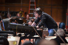 Composer/conductor Thomas Newman checks with the playback