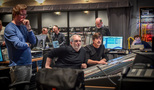 Director Andrew Stanton, scoring mixer Thomas Vicari, and composer Thomas Newman listen to the mix