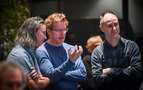 Director Andrew Stanton (center) talks with Unforgettable song producer/arranger Oliver Kraus and music supervisor Tom MacDougall