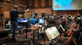 Composer/conductor Thomas Newman and the orchestra record his score for <i>Finding Dory</i>
