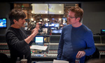 Composer Thomas Newman discusses a cue with director Andrew Stanton