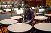 Greg Goodall tunes the timpani