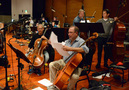 The cellos and basses prepare for the next cue