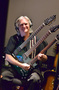 Guitarist George Doering shows off his three-neck guitar