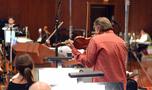 Violinist Bruce Dukov prepares to tune with orchestra