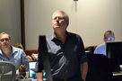 Alan Menken listens to the mix as he watches the playback